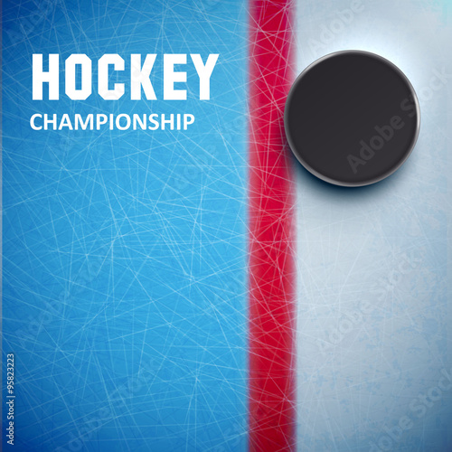 fototapeta na szkło Hockey puck isolated on ice top view