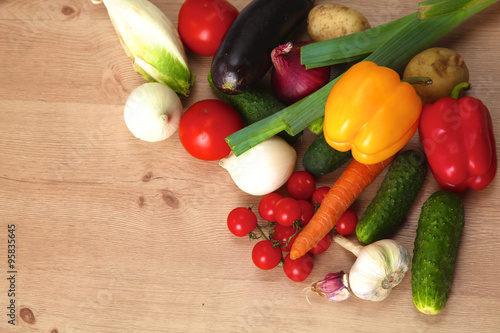 Fotobehang Pile of organic vegetables on a wooden table