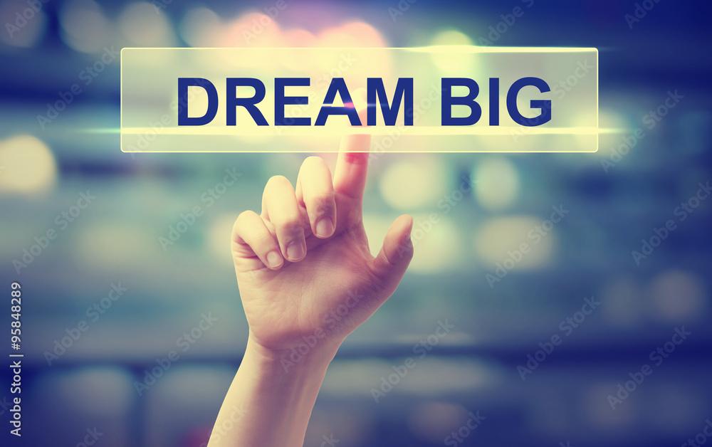 Fototapeta Dream Big concept with hand pressing a button