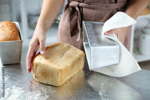 Door stickers Bread Baker with freshly baked bread in kitchen of bakery