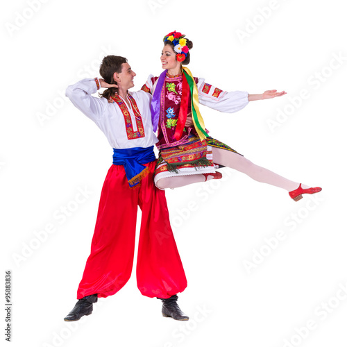 Fotografía  beautiful dancing couple in ukrainian polish national traditional costume clothe