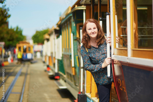 Spoed Foto op Canvas Mediterraans Europa Tourist taking a ride in famous cable car in San Francisco