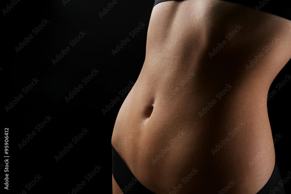 Fototapety, obrazy: Slim female body in nice black lingerie on dark background
