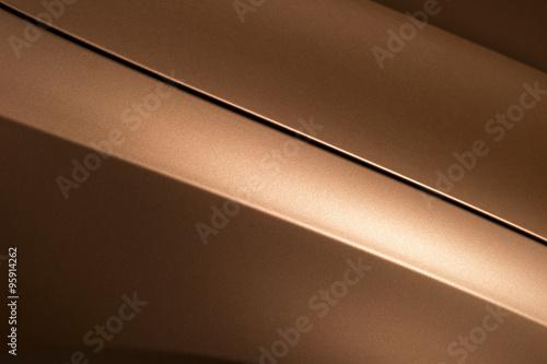 Fotografie, Obraz  Surface of bronze sport sedan car, detail of metal hood and fender of vehicle bo