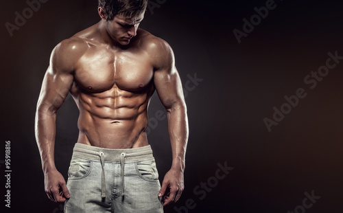 Fotomural  Strong Athletic Man Fitness Model Torso showing six pack abs., c