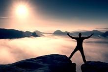 Funny Jumping Hiker In Black Celebrate Triumph. Stay Between Two Rocky Peaks. Wonderful Misty Daybreak.