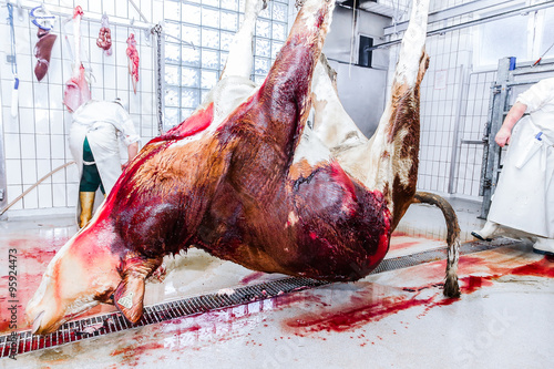 Butcher in a slaughterhouse Canvas Print