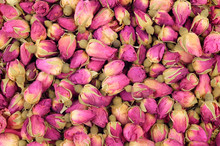 Background Of A Large Quantity Of Dried Buds Pink Tea Rose.