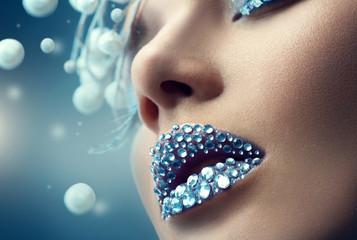 Christmas girl. Holiday makeup with gems on lips