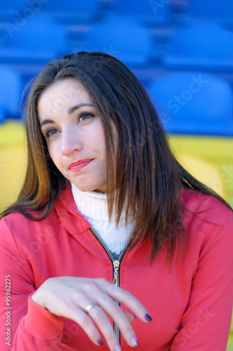 Fotografía  Girl cheerleader sitting unhappy game