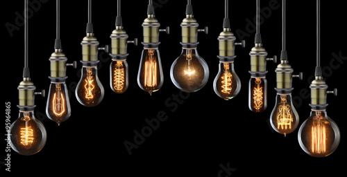 Papiers peints Retro Set of vintage glowing light bulbs on black
