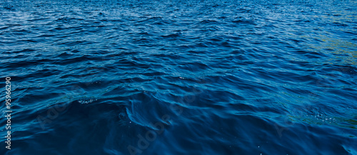 close up blue water surface at deep ocean