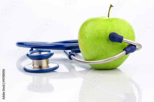 Fotografie, Obraz  Apfel und Stethoskop