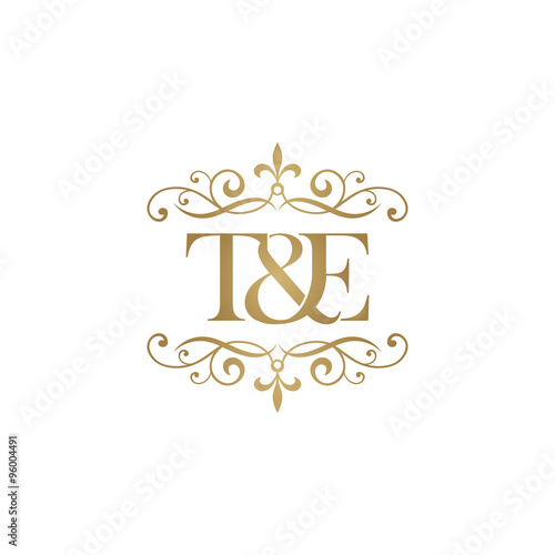 Photo  T&E Initial logo. Ornament ampersand monogram golden logo