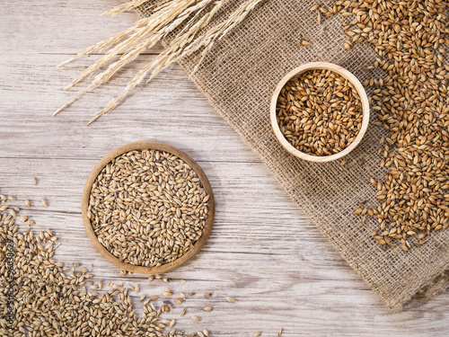 Fotografia, Obraz  Top view - Beer ingredients, Pale ale and caramel malt on wooden background