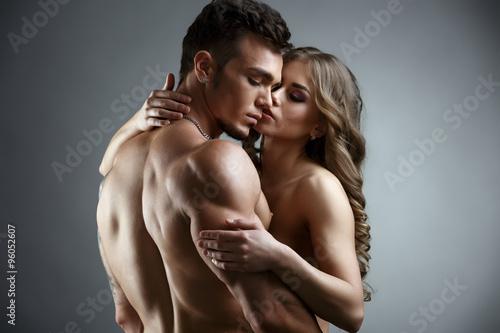 Photo  Erotica. Embrace of attractive nude couple