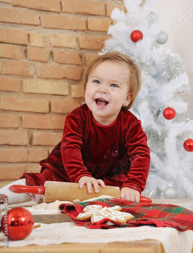 6ecf61cab happy little baby girl with big blue eyes in red dress making co ...