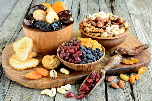 Foto op Plexiglas Vruchten Mix of dried fruits and nuts - symbols of judaic holiday Tu Bishvat