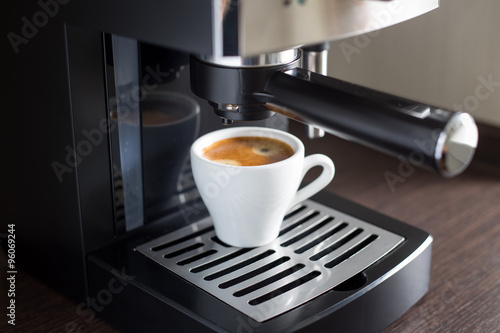 Fotografie, Obraz  White ceramic cup of espresso with coffee machine