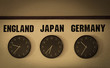 different time of 3 countrys (England, Japan, Germany) on the vintage clocks on the wall