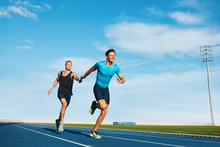 Athletes Pass The Baton In A T...