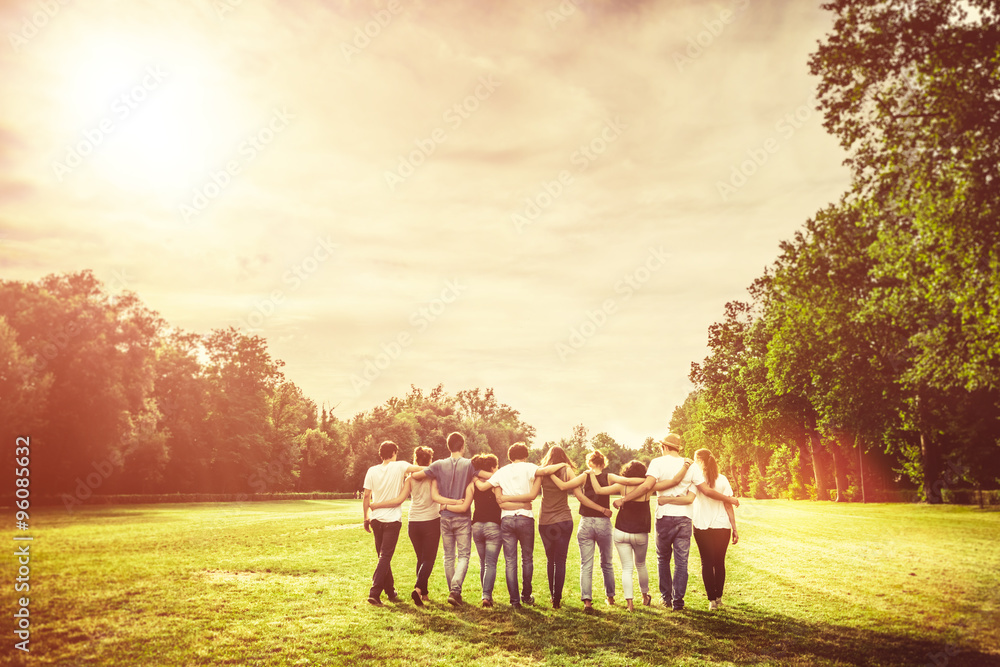 Fototapety, obrazy: Group of Teenage Friends in the Park at Sunset