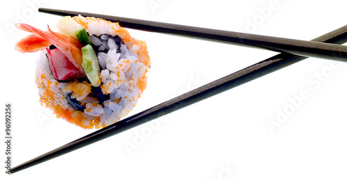 Photo Sushi and chopsticks isolated on white.