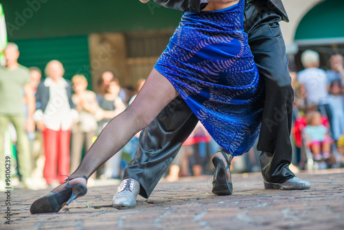 Couple dancing tango in the street