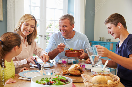 Family Enjoying Meal At Home Together - 96107677