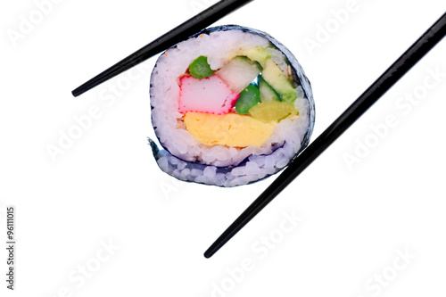 Sushi roll with black chopsticks isolated on white background Canvas