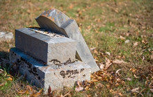Neglected Tombstone In Cemetery