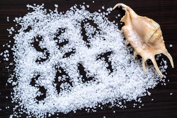 Scattered sea salt and seashell