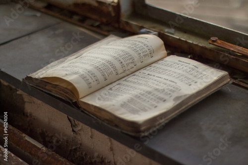 Old hymn book in a ruin Wallpaper Mural