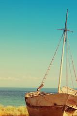 Fototapeta Morze Boat framework on a beach against the sea in Greece. Old Fisherman Boat