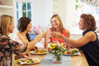 canvas print picture - Mature Female Friends Sitting Around Table At Dinner Party