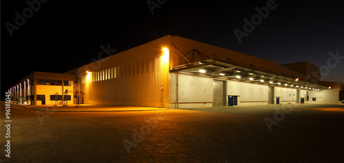 Fototapeta  External wide angle view of modern warehouse at night