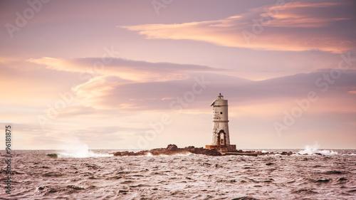 Poster Vuurtoren Lighthouse in the sea at sunset - Faro Mangiabarche Calasetta