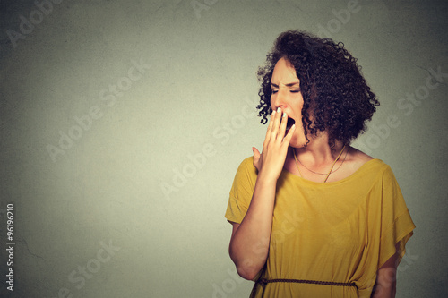 Fotografie, Obraz  sleepy young woman with wide open mouth yawning eyes closed looking bored