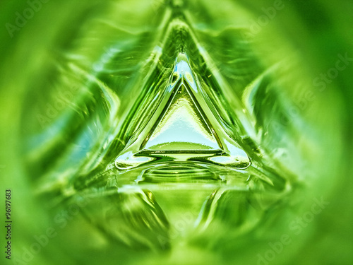 Papiers peints Cactus Abstract inside triangle glass bottle emerald green background