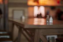 Salt And Pepper On The Wood Table