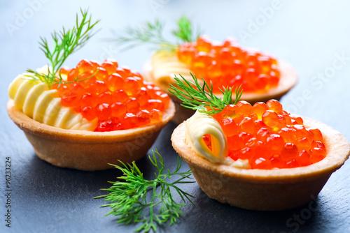 Tartlets with red caviar closeup. Gourmet food