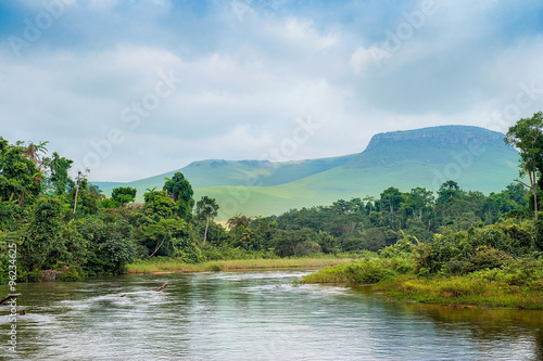 Printed kitchen splashbacks River River in the Jungle. Small river in jungle. Under the cloudy sky