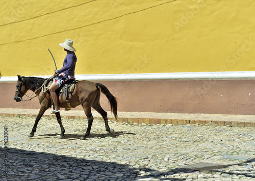 Cuban local man on horse on street in Trinidad, Cuba. Wallpaper Mural