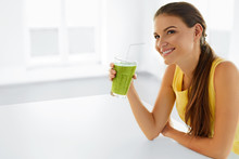 Healthy Lifestyle. Closeup Of Beautiful Smiling Woman Drinking Green Detox Vegetable Juice. Healthy Diet And Eating. Vegetarian Food. Drink Smoothie. Health Care And Beauty Concept.