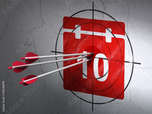 Photo  Time concept: arrows in Calendar target on wall background