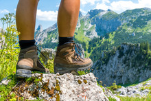 Climbing In The Mountains With Mountain Boots