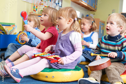 Photo  Group Of Pre School Children Taking Part In Music Lesson