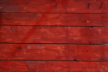 Red vintage painted wooden panel with horizontal planks