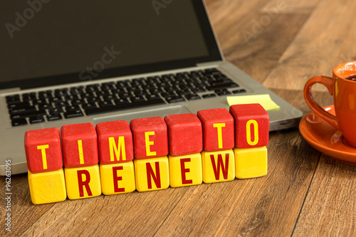 Time to Renew written on a wooden cube in a office desk Wallpaper Mural