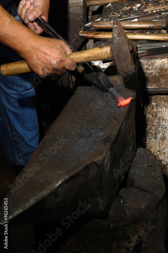 Fotografia, Obraz  Blacksmith forges iron in the forge